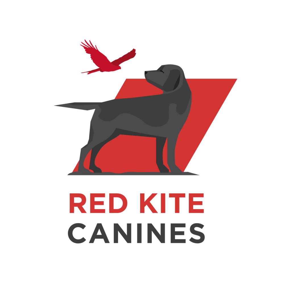 Red Kite logo featuring labrador and red kite standing in front of a red rhombus.